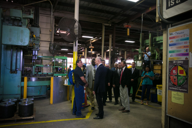 Rick Scott greeting workers