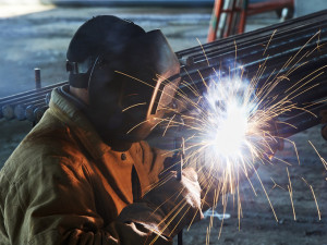 Welder Working on a Pump